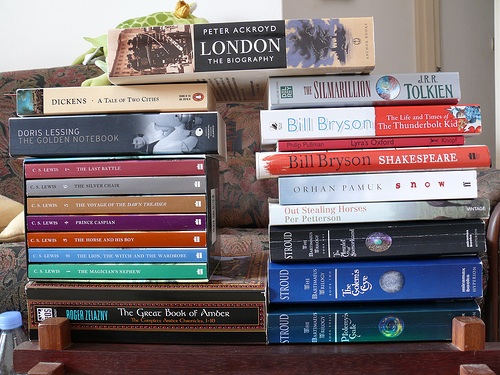 Stack of fiction books on a desk